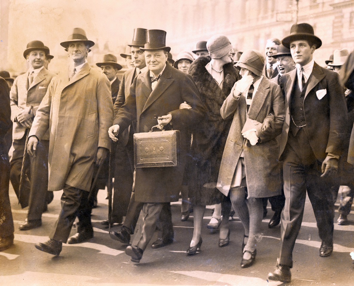 Winston Churchill, Chancellor of the Exchequer, carries the dispatch box on his way to the House of Commons, in London, to present the budget, April 29, 1929.